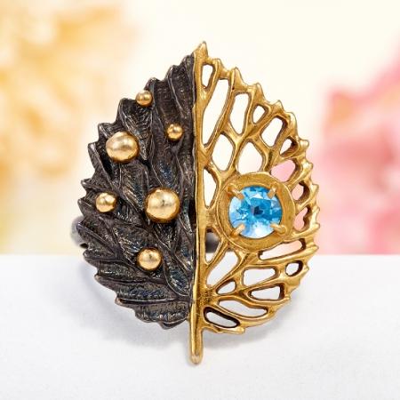 Кольцо топаз голубой  огранка (серебро 925 пр., позолота) размер 19,5
